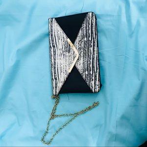 Aldo black white print clutch w strap